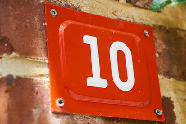 Number 10 fastened to a brick wall